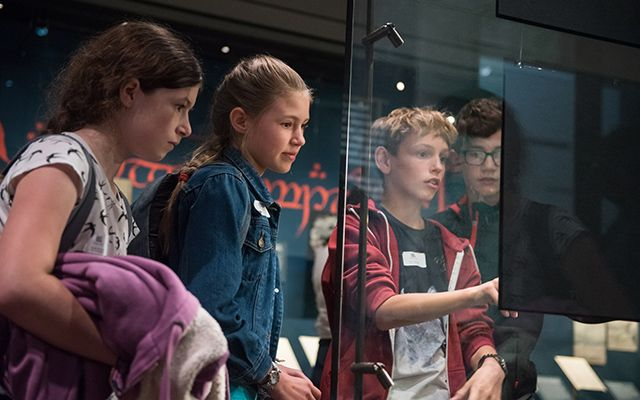 Group of children looking at the display