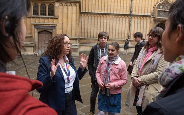 Tour guide and visitors at the Bodleian Libraries