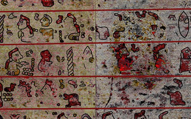 Section of ancient codex with pictures, symbols and bright colours
