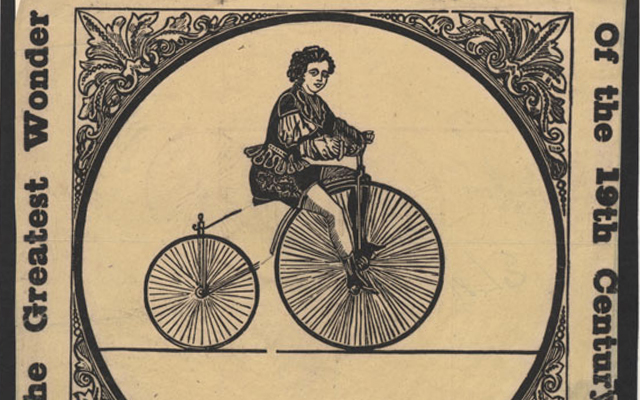 Black-and-white image of person on early bicycle