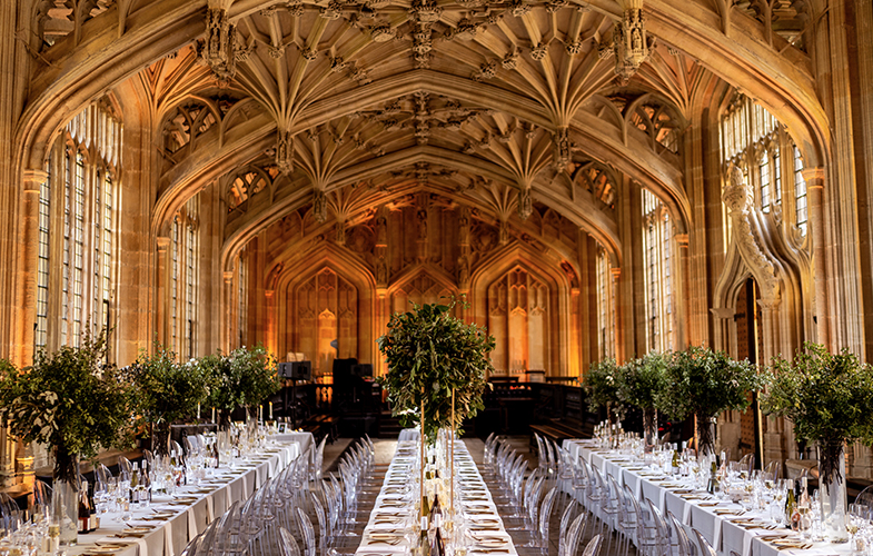 Divinity School set up for a wedding reception with three long tables set for dinner