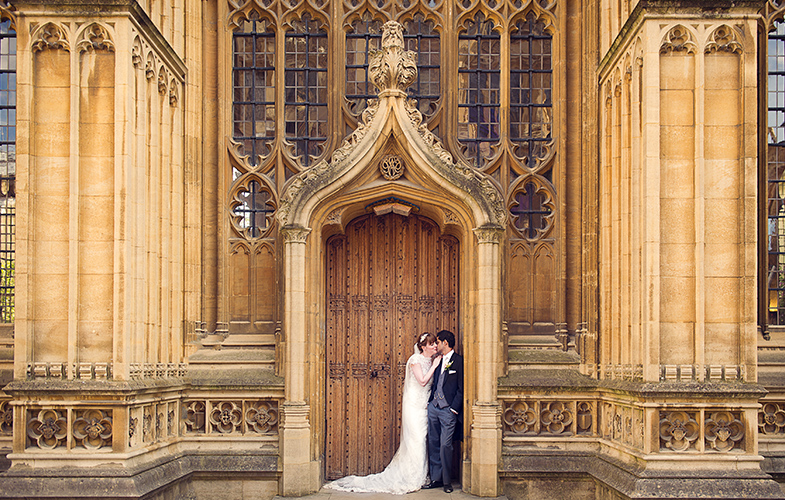 Wedding couple on the Wren Door, Divinity School, Oxford