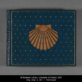 Ornate inlaid leather book cover showing a shell on a navy background