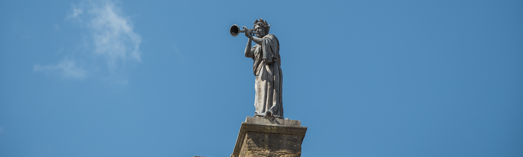 Statue of one of the nine Muses above the Clarendon Building, Oxford