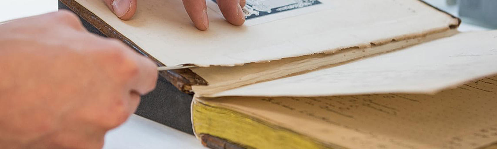 A damaged book being repaired
