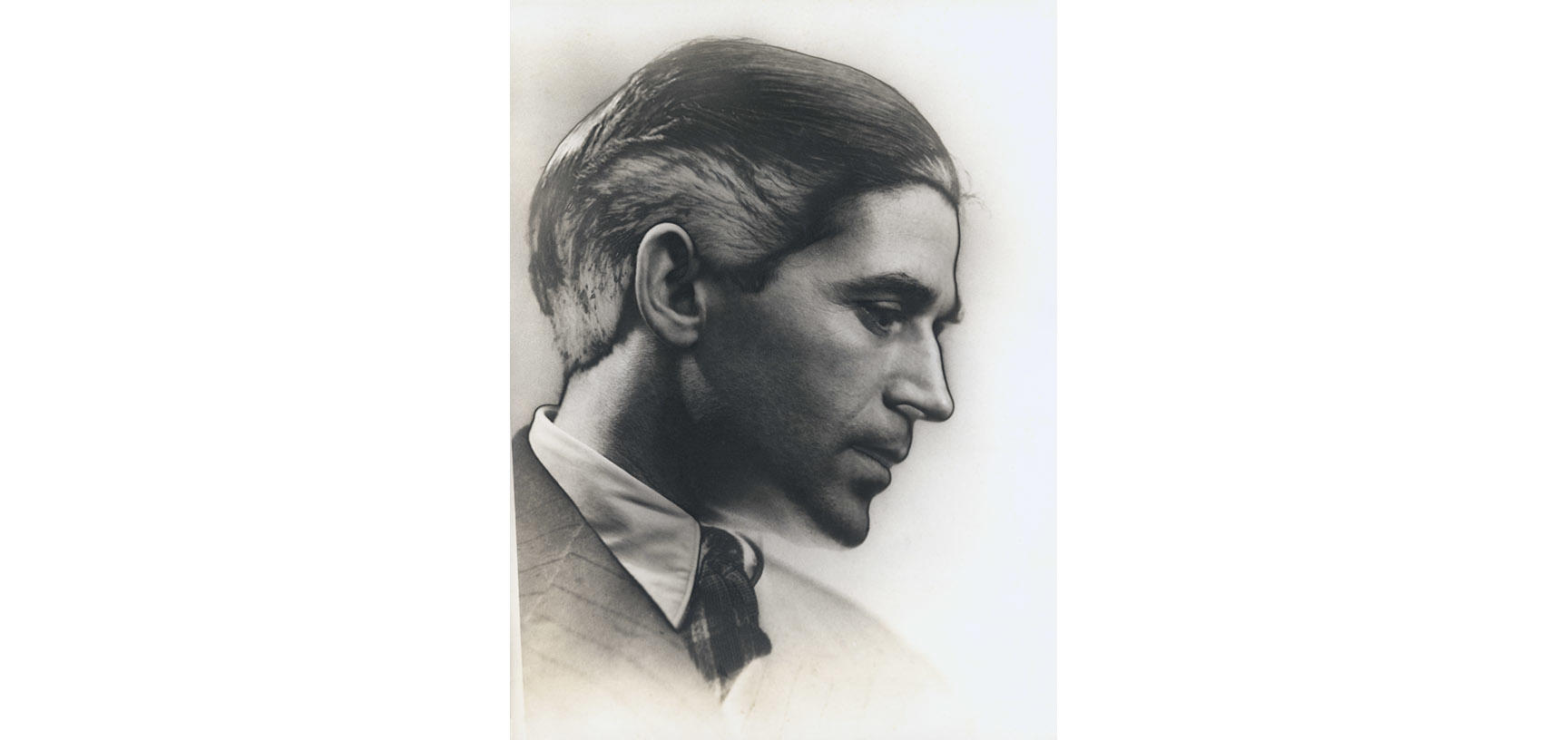 A photograph of a young man in profile