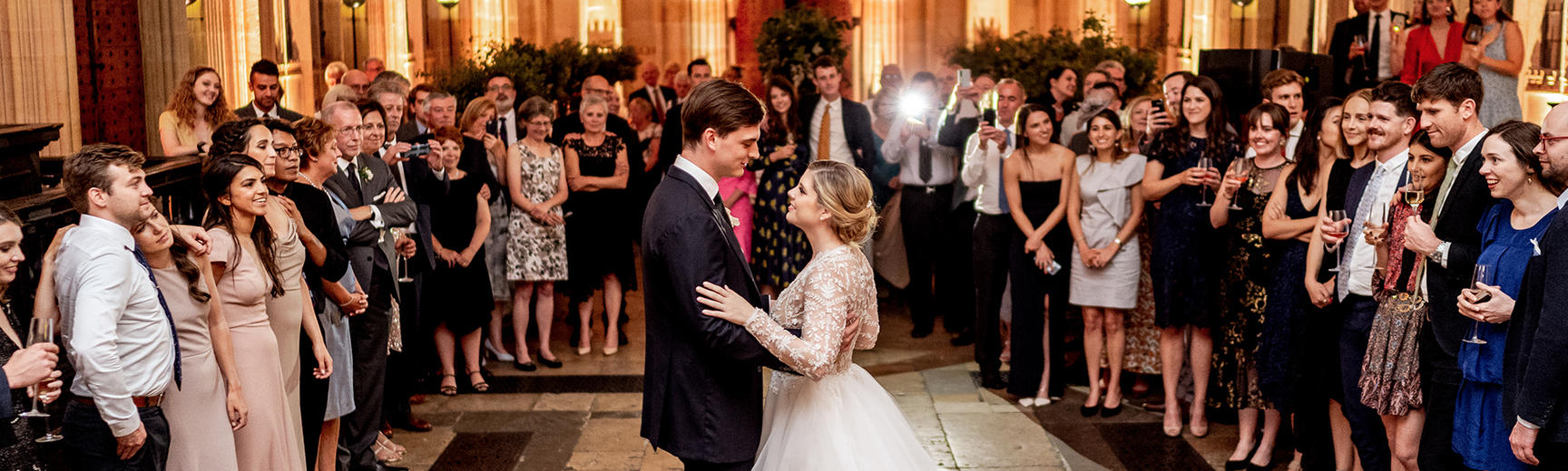 Newlyweds enjoying their first dance in Divinity School