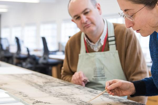 Researchers working in the Conservation and Collection care studio, Bodleian Libraries, Oxford