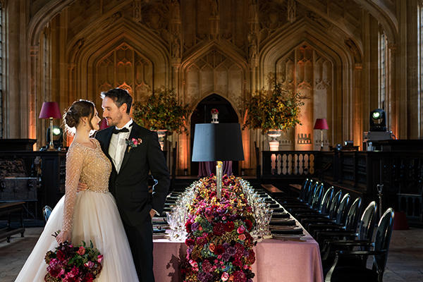 Dramatic styled shoot of a bride and groom in Divinity School