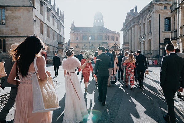 Wedding guests mingling outside the Bodleian Libraries