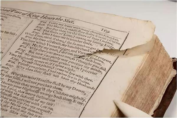 Image of a torn page of a Shakespeare folio