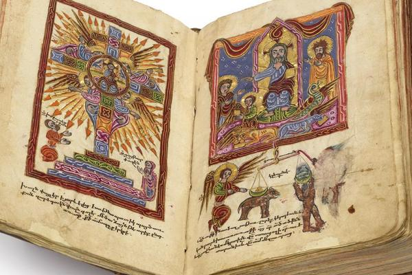 An open book with illuminated illustrations on each page