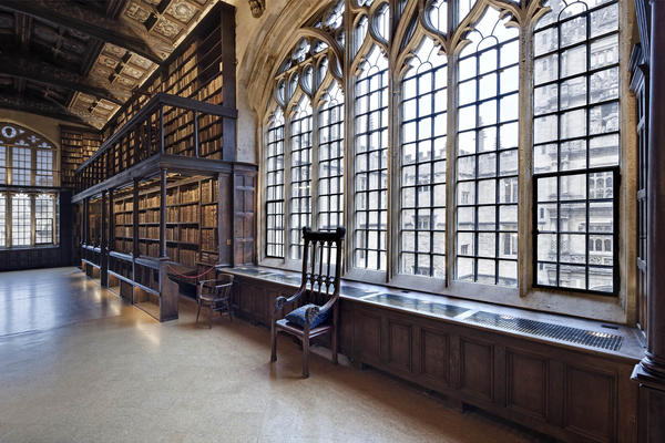 A large window with bookcases either side in the Duke Humfreys
