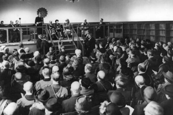 Photo of King George VI talking to an audience in the library