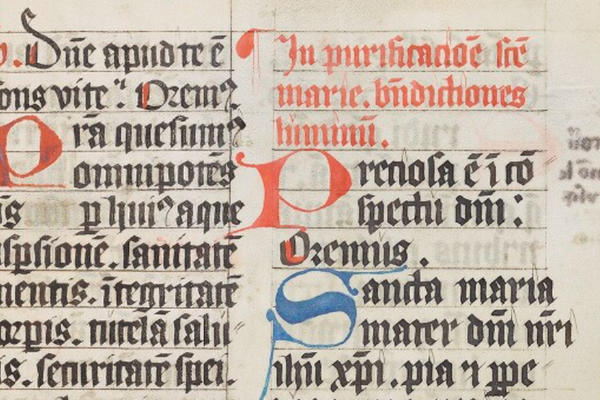 A manuscript with medieval Latin text in black