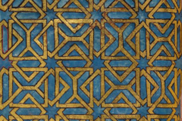 A blue and gold motif from a manuscript