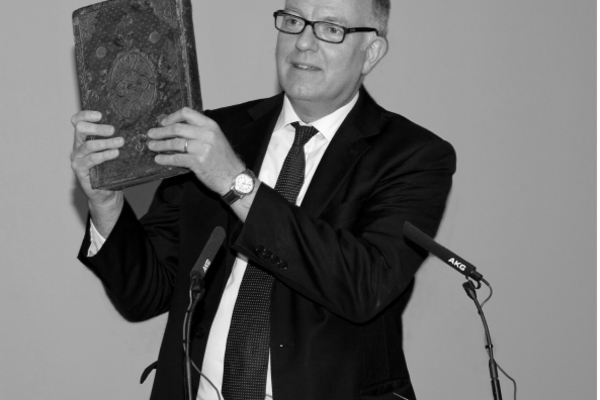 Richard Ovenden, holding Elizabeth I's copy of Plato's complete works in Greek