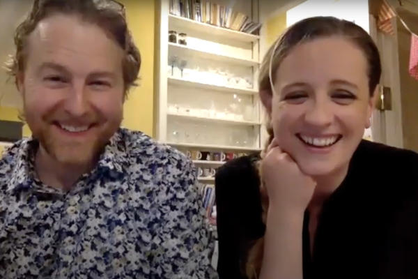 A man and a woman sitting next to each other on a Zoom call