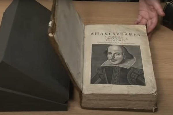 The manuscript of Shakepeare's First Folio leaning on supporting black foam
