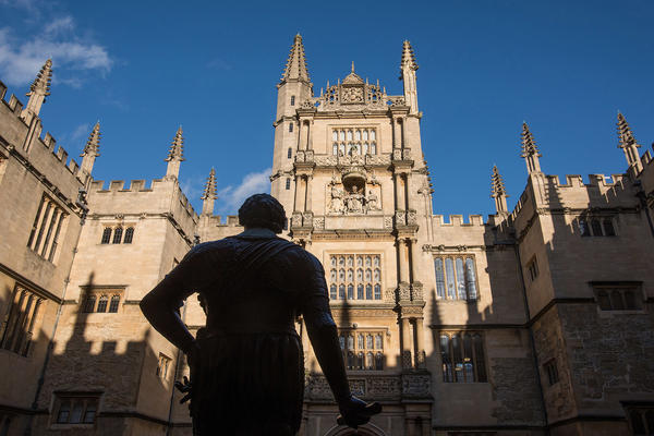 The quadrangle at the Bodleian Old Library with the statue of the Earl of Pembroke in the foreground