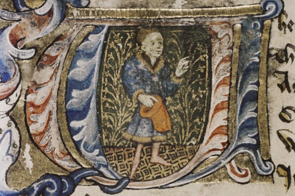 An illuminated letter W showing a picture of a man