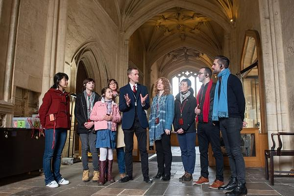 Group of people visiting the Proscholium, Old Bodleian Library