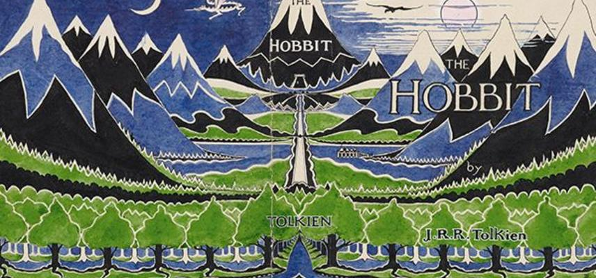 "An illustration of mountains and trees in green and yellow with the word ""Hobbit"""