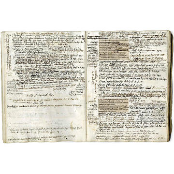 A open book with lines and lines of handwritten notes - some lines are scratched out