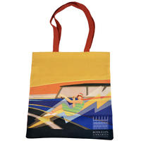 A bag with a stylised image of a woman in a green dress driving a blue car on a yellow background
