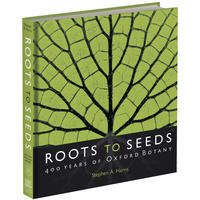 The front cover of the Roots to Seeds exhibition book - it has a vibrant green leaf design with the book title at the bottom on black